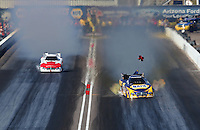 Feb. 23, 2013; Chandler, AZ, USA; NHRA funny car driver Ron Capps (right) alongside Todd Lesenko during qualifying for the Arizona Nationals at Firebird International Raceway. Mandatory Credit: Mark J. Rebilas-
