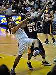 13 December 2008: Albany's Jimmie Covington and Canisius' Chris Gadley battle for a rebound in a game between Canisius and Albany won by Albany 74-46 at SEFCU Arena in Albany, New York.
