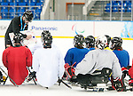 Sochi, RUSSIA - Mar 1 2014 -  Head Coach Mike Mondin gives the team instructions during their first practice before the 2014 Paralympics in Sochi, Russia.  (Photo: Matthew Murnaghan/Canadian Paralympic Committee)