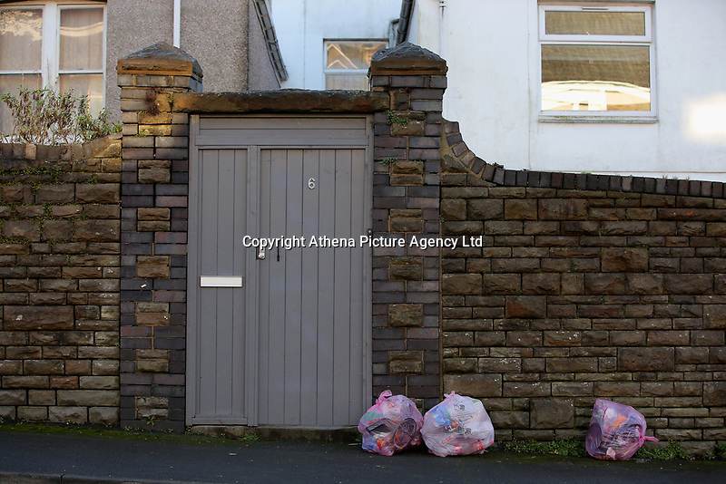 Pink bags used for the household recycling of plastics and bins used for the recycling of food, on Cromwell Street in the Mount Pleasant area of Swansea, Wales, UK. Wednesday 29 November 2017