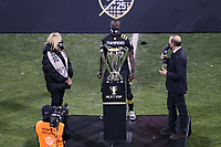 COLUMBUS, OH - DECEMBER 12: MLS Commissioner Don Garber presents the Philip F. Anschutz MLS Cup Championship Trophy to Columbus Crew SC owner Dee Haslam and team captain Jonathan Mensah #4 after a game between Seattle Sounders FC and Columbus Crew at MAPFRE Stadium on December 12, 2020 in Columbus, Ohio.