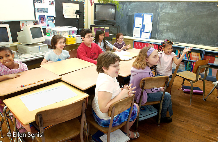 MR / Schenectady, NY.Yates Arts-in-Education Magnet School (urban elementary school) .Grade 4.Eager students wait in classroom..MR: g4m.© Ellen B. Senisi
