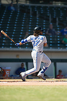 Surprise Saguaros third baseman Vladimir Guerrero Jr. (27), of the Toronto Blue Jays organization, follows through on his swing during an Arizona Fall League game against the Mesa Solar Sox at Sloan Park on November 1, 2018 in Mesa, Arizona. Surprise defeated Mesa 5-4 . (Zachary Lucy/Four Seam Images)