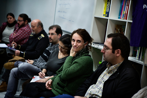 Madrid, Spain, February 12, 2015. A member of the left wing [party] Podemos smiles during their weekly meeting in Salamanca's neighbourhood in Madrid.