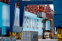 The Mary Maersk, the largest container ship in the world, is loaded with containers.