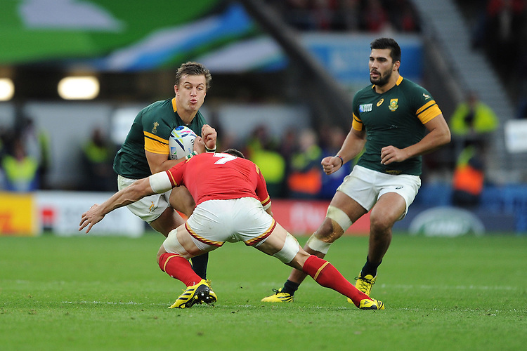 Handre Pollard of South Africa is tackled by Sam Warburton of Wales during Match 41 of the Rugby World Cup 2015 between South Africa and Wales - 17/10/2015 - Twickenham Stadium, London<br /> Mandatory Credit: Rob Munro/Stewart Communications
