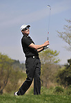 JEJU, SOUTH KOREA - APRIL 25:  Brett Rumford of Australia tees off on the 14th hole during the Round Three of the Ballantine's Championship at Pinx Golf Club on April 25, 2010 in Jeju, South Korea. Photo by Victor Fraile / The Power of Sport Images