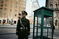 CHINA. Shanghai. A soldier stands guard near the Bund. Shanghai is a sprawling metropolis or 15 million people situated in south-east China. It is regarded as the country's showcase in development and modernity in modern China. This rapid development and modernization, never seen before on such a scale has however spawned countless environmental and social problems. 2008