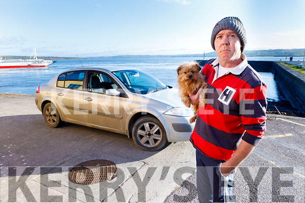 Timmy Mulvihill from Tarbert who is homeless, standing with his dog, and living in his car on Tarbert Pier for the past 2 years.