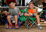 SARATOGA SPRINGS, NY - AUGUST 25: Two young fans eat sandwiches in the picnic area on Travers Stakes Day at Saratoga Race Course on August 25, 2018 in Saratoga Springs, New York. (Photo by Scott Serio/Eclipse Sportswire/Getty Images)