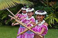 Pretty Hawaiian girls dancing with puili sticks, Oahu, Hawaii