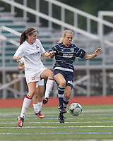 Boston Aztec defender Jessica Morrow (26) and Seacoast United Phantoms player Rachel Hill (6) battle for the ball.  In a Women's Premier Soccer League (WPSL) match, Boston Aztec (white) defeated Seacoast United Phantoms (blue), 3-0, at North Reading High School Stadium on Arthur J. Kenney Athletic Field on on June 25, 2013.