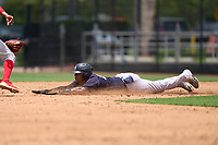 New York Yankees Anthony Garcia (66) slides head first into second base during an Extended Spring Training game against the Philadelphia Phillies on June 22, 2021 at the Carpenter Complex in Clearwater, Florida. (Mike Janes/Four Seam Images)