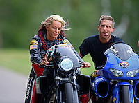 Aug 20, 2016; Brainerd, MN, USA; NHRA pro stock motorcycle rider Angie Smith (left) and Michael Ray during qualifying for the Lucas Oil Nationals at Brainerd International Raceway. Mandatory Credit: Mark J. Rebilas-USA TODAY Sports