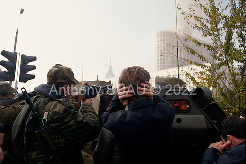 Moscow, Russia.October 4, 1993..Russian troops take up positions on Novy Arbat Street, near the US Embassy, surrounding the Parliament building in hopes of removing hundreds of well armed anti-Yeltsin demonstrators held up inside. ..Russian soldiers fire at will at anti-Yeltsin demonstrators.