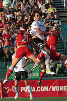 Abby Wambach of the magicJack collides with Brittany Bock and Becky Edwards of the Western New York Flash while trying to win a ball out of the air. The Western New York Flash defeated the magicJack 3-0 in Women's Professional Soccer (WPS) at Sahlen's Stadium in Rochester, NY on May, 22 2011.