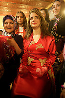 Traditional Kurdish wedding or kina gecesi in Istanbul, Turkey. The bride has had her hands daubed with henna and bound in gauze