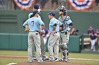 Main Black Bears head coach Steve Trimper talks with starting pitcher Chris Murphy (31) as third baseman Danny Casals (7) and catcher Kevin Stypulkowski (33) watch on during a game against the Clemson Tigers at Doug Kingsmore Stadium on February 20, 2016 in Clemson, South Carolina. The Tigers defeated the Black Bears 9-4. (Tony Farlow/Four Seam Images)