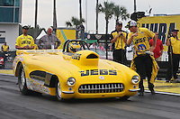 Mar. 17, 2013; Gainesville, FL, USA; NHRA super gas driver Troy Coughlin Jr is directed to stage by Jeg Coughlin Jr during the Gatornationals at Auto-Plus Raceway at Gainesville. Mandatory Credit: Mark J. Rebilas-