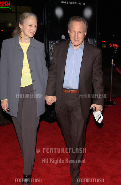 Director MICHAEL MANN & wife at the world premiere, in Hollywood, of Friday Night Lights..October 6, 2004