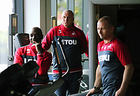 (L-R) Assistant coaches Claude Makelele, Nigel Gibbs and Karl Halabi watch the players exercise in the gym during the Swansea City Training at The Fairwood Training Ground, Swansea, Wales, UK. Thursday 10 August 2017