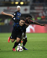 Calcio, Serie A: AC Milan - Inter Milan, Giuseppe Meazza (San Siro) stadium, Milan on 17 March 2019.  <br /> Inter's Lautaro Martinez (l) in action with Milan's Frank Kessie  (r) during the Italian Serie A football match between Milan and Inter Milan at Giuseppe Meazza stadium, on 17 March 2019. <br /> UPDATE IMAGES PRESS/Isabella Bonotto
