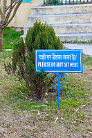 India, Dehradun.  Bilingual Sign Prohibiting Sitting on the Grass on the Grounds of the Buddhist Temple of Dehradun and Mindrolling Monastery.