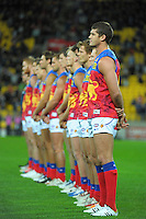 The Lions line up for the national anthems before the Australian Rules Football ANZAC Day match between St Kilda Saints and Brisbane Lions at Westpac Stadium, Wellington, New Zealand on Friday, 25 April 2014. Photo: Dave Lintott / lintottphoto.co.nz