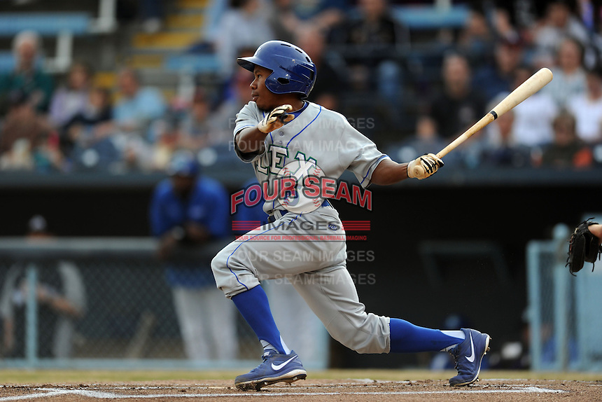 Lexington Legends left fielder Terrance Gore #6 swings at a pitch during a game against the  Asheville Tourists at McCormick Field on April 23, 2013 in Asheville, North Carolina. The Tourists won the game 4-3. (Tony Farlow/Four Seam Images).