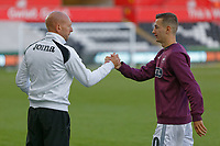 Adrian Tucker, goalkeeping coach for Swansea congratulates Bersant Celina after the Sky Bet Championship match between Swansea City and Queens Park Rangers at the Liberty Stadium, Swansea, Wales, UK. Saturday 29 September 2018