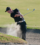 JSerra Catholic High School golfer drives the ball out of the sand trap.