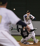Reno Aces shortstop Chris Owings turns a double play against the Sacramento River Cats during their game played on Friday night, April 12, 2013 in Reno, Nevada.