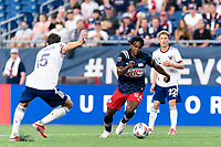 FOXBOROUGH, MA - AUGUST 18: DeJuan Jones #24 of New England Revolution on the attack during a game between D.C. United and New England Revolution at Gillette Stadium on August 18, 2021 in Foxborough, Massachusetts.