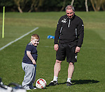 Rangers manager Ally McCoist takes a young supporter onto the training park