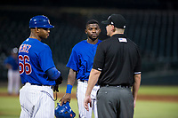 AZL Cubs assistant hitting coach Leonel Perez (66) and shortstop Delvin Zinn (21) talk to field umpire Pete Talkington during a game against the AZL Giants on September 6, 2017 at Sloan Park in Mesa, Arizona. AZL Giants defeated the AZL Cubs 6-5 to even up the Arizona League Championship Series at one game a piece. (Zachary Lucy/Four Seam Images)