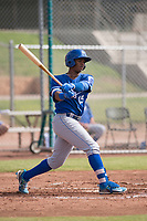Khalil Lee (15) of the Kansas City Royals follows through on his swing during an Instructional League game against the San Francisco Giants at the Giants Training Complex on October 17, 2017 in Scottsdale, Arizona. (Zachary Lucy/Four Seam Images)