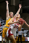 SIOUX FALLS, SD - MARCH 8: Hannah Sjerven #34 of the South Dakota Coyotes eyes the basket in front of Emily Dietz #34 of the North Dakota State Bison during the Summit League Basketball Tournament at the Sanford Pentagon in Sioux Falls, SD. (Photo by Dave Eggen/Inertia)