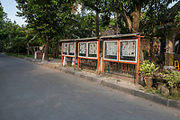 Yogyakarta, Java, Indonesia.  Daily Newspaper in Public Reading Display on a Residential Street.