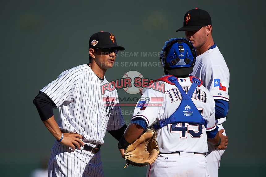 Surprise Saguaros pitching coach Jose Rosado (47) mound meeting with catcher Jose Trevino (45) and pitcher Connor Sadzeck (55) during an Arizona Fall League game against the Glendale Desert Dogs on October 23, 2015 at Salt River Fields at Talking Stick in Scottsdale, Arizona.  Glendale defeated Surprise 9-6.  (Mike Janes/Four Seam Images)