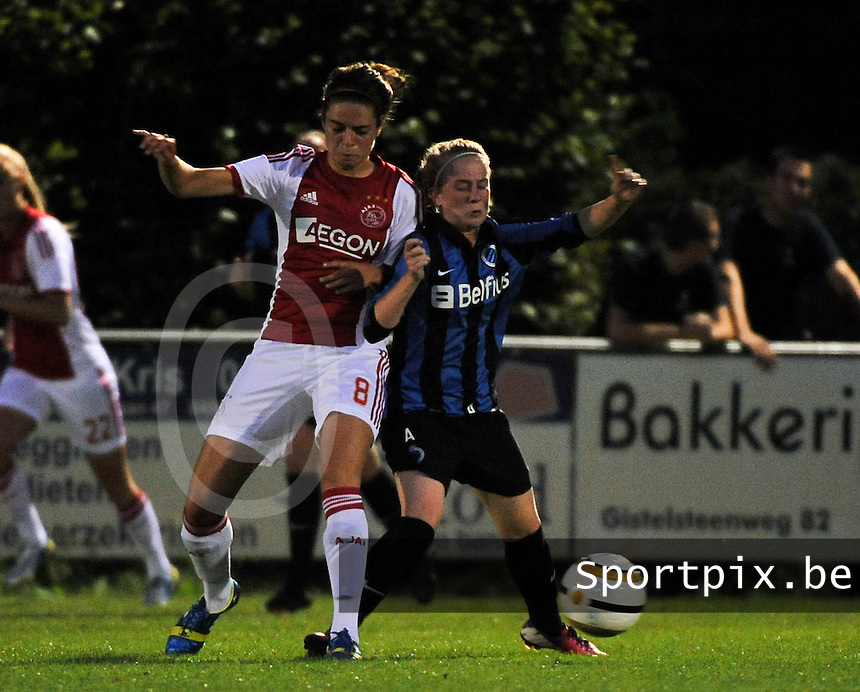 20130830 - VARSENARE , BELGIUM : duel being pictured between Brugge's Silke Demeyere (right) and Ajax' Tessel Middag during the female soccer match between Club Brugge Vrouwen and Ajax Amsterdam Dames , of the first matchday in the BENELEAGUE competition. Friday 30 August 2013. PHOTO DAVID CATRY
