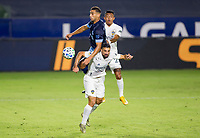 CARSON, CA - OCTOBER 18: Ali Adnan #53 of the Vancouver Whitecaps battles with Sebastian Lletget #17 and Julian Araujo #22 of the Los Angeles Galaxy for a ball in the air during a game between Vancouver Whitecaps and Los Angeles Galaxy at Dignity Heath Sports Park on October 18, 2020 in Carson, California.