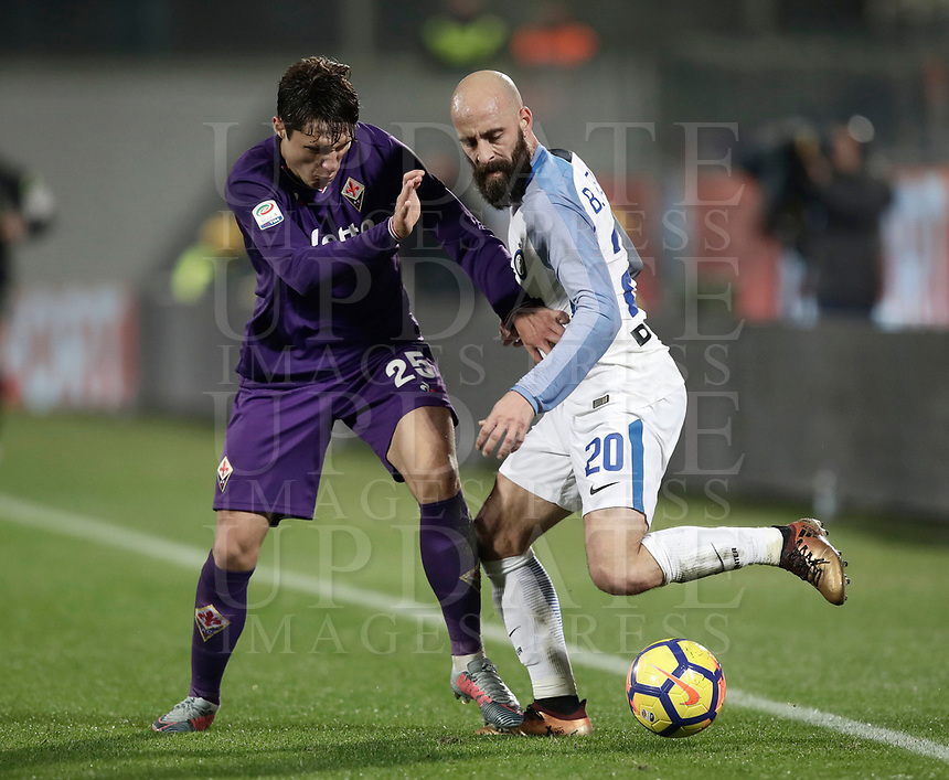 Calcio, Serie A: Fiorentina - Inter, stadio Artemio Franchi Firenze 5 gennaio 2018.<br /> Inter's Borja Valero (r) in action with Fiorentina's Federico Chiesa (l) during the Italian Serie A football match between Fiorentina and Inter Milan at Florence's Artemio Franchi stadium, January 5 2018.<br /> UPDATE IMAGES PRESS/Isabella Bonotto