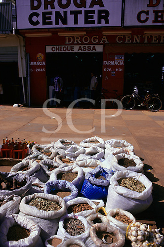 "Altamira, Para State, Brazil. Medical herbs on sale in a street front of a ""Drug Centre""(pharmacy)."