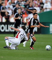 DC United midfielder Christian Castro keeps his feet despite attempts at blockage by Real Salt Lake midfielder Ned Grabavoy.  DC United tied Real Salt Lake 0-0 at  RFK Stadium, Saturday May 23, 2009.