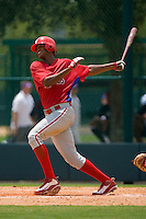 Domingo Santana #13 of the GCL Phillies follows through on his swing versus the GCL Braves at Disney's Wide World of Sports Complex, July 13, 2009, in Orlando, Florida.  (Photo by Brian Westerholt / Four Seam Images)