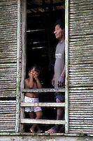 Father and son watching the world go by. Biroquera, Darien, Panama.