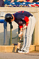 Bryce Harper #34 of the Hagerstown Suns applies some pine tar to his bat during the game against the Rome Braves at State Mutual Stadium on April 30, 2011 in Rome, Georgia.   Photo by Brian Westerholt / Four Seam Images