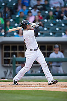 Kevan Smith (32) of the Charlotte Knights follows through on his swing against the Scranton\Wilkes-Barre RailRiders at BB&T BallPark on May 1, 2015 in Charlotte, North Carolina.  The RailRiders defeated the Knights 5-4.  (Brian Westerholt/Four Seam Images)