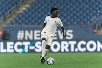 FOXBOROUGH, MA - AUGUST 5: Malick Mbaye #5 of North Carolina FC looks to pass during a game between North Carolina FC and New England Revolution II at Gillette Stadium on August 5, 2021 in Foxborough, Massachusetts.