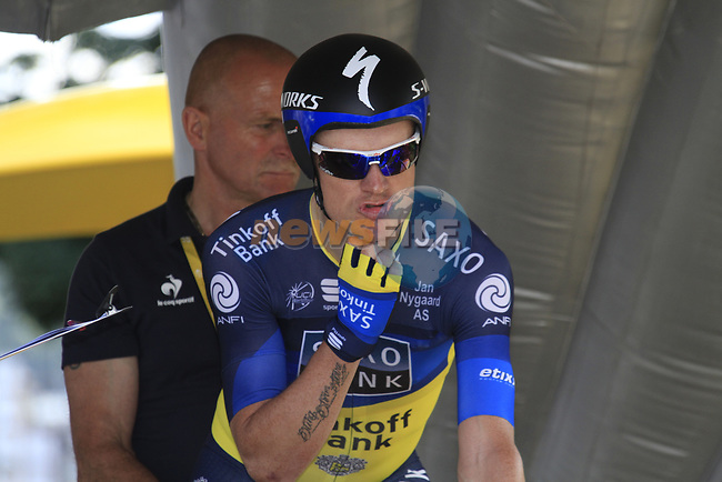 Nick Nuyens (BEL) Saxo Bank-Tinkoff Bank adjusts his helmet strap as he waits on the start ramp during the Prologue of the 99th edition of the Tour de France 2012, a 6.4km individual time trial starting in Parc d'Avroy, Liege, Belgium. 30th June 2012.<br /> (Photo by Eoin Clarke/NEWSFILE)